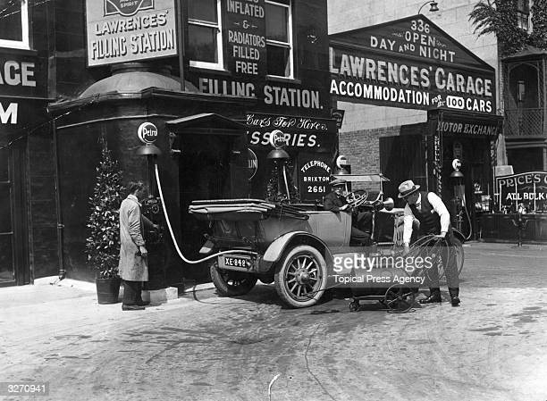 Refuelling a car at Shell Mex filling station in Clapham south London