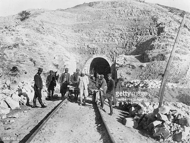Turkish prisoners at work in a prisoner of war camp while their Greek captors watch over them