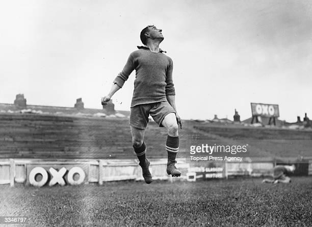 Brentford footballer Rosier prepares to head the ball during training