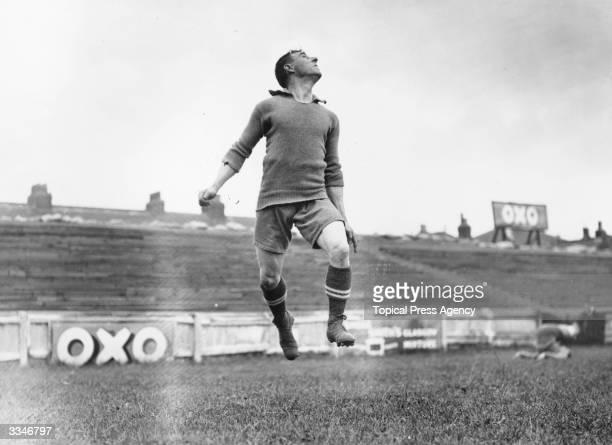 Brentford footballer, Rosier, prepares to head the ball during training.