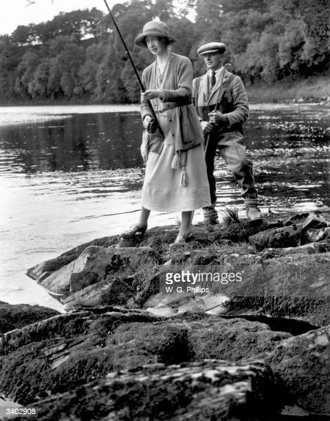 Hon Mrs MacDonald daughter of Lord Woolavington fly fishing in a river in Scotland