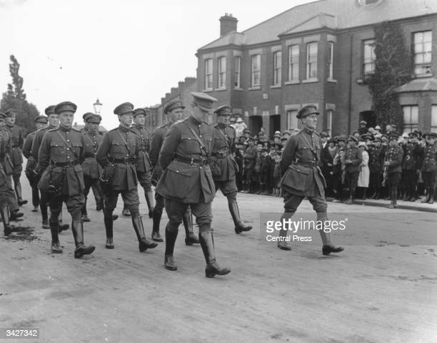Irish politician and Sinn Fein leader Michael Collins and General Richard Mulcahy marching in uniform at the head of the procession at the funeral of...