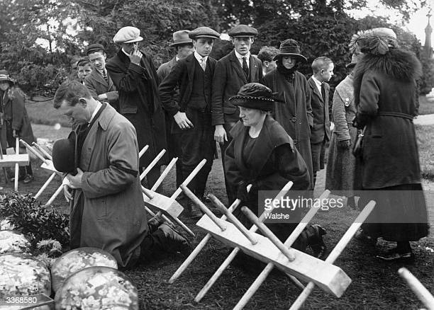 Miss J Collins and Sean Collins praying at the graveside of Irish nationalist politician soldier and Sinn Fein leader Michael Collins who was shot...