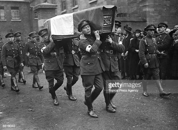 Red Cross men carrying the coffin of one of twelve soldiers who were killed in Dublin during the Irish Civil War
