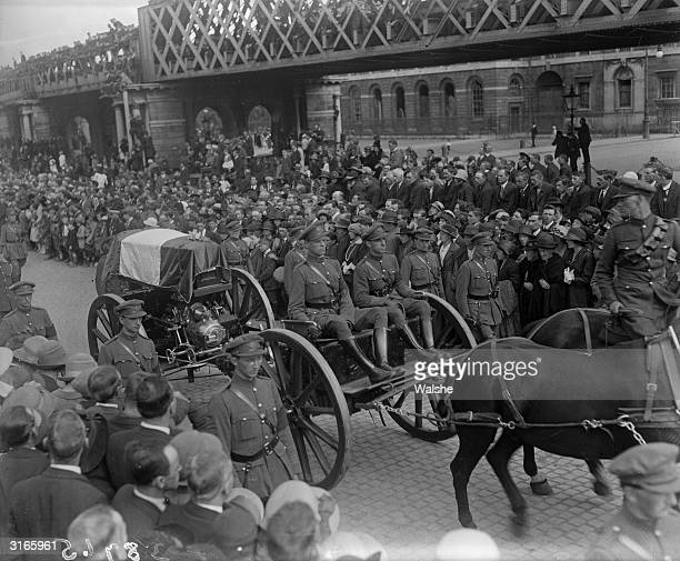 The coffin of Michael Collins the leader of the Free State forces who was assassinated by the IRA being driven through the streets of Dublin with a...