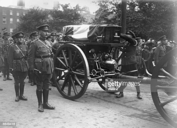 The Irish tricolour is placed on the coffin of the soldier politician and Sinn Fein leader Michael Collins at his funeral in Dublin Collins was...