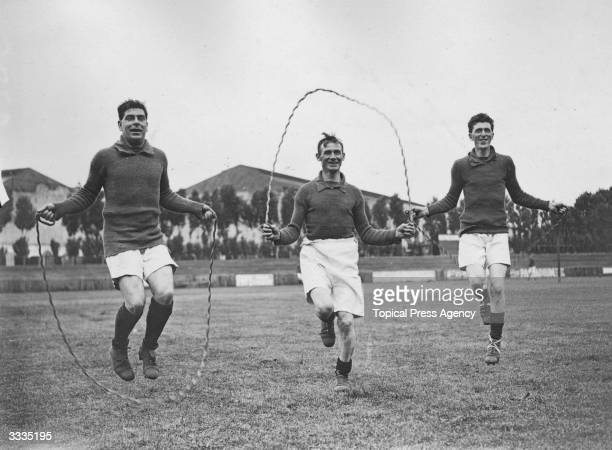 Three soccer players Bain J Birch and Edgeley from Queens Park Rangers FC skipping