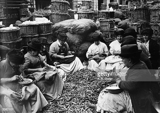 Women at work shelling peas at Covent Garden Market London during a strike