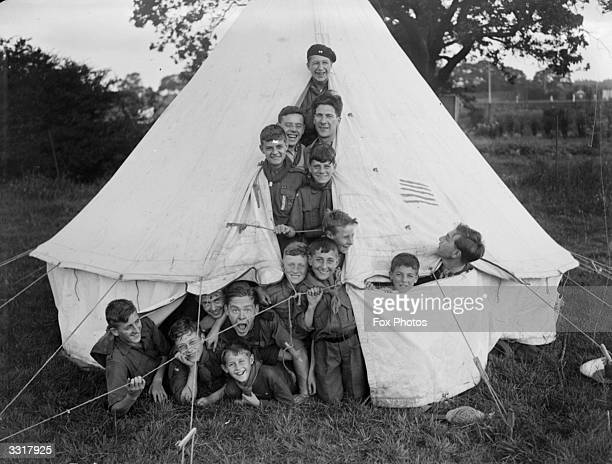 Boy Scouts crammed into a tent during a camping holiday at Muswell Hill in London