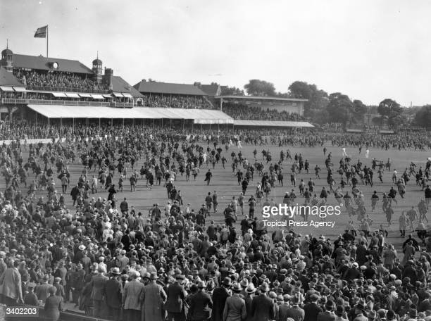 Crowds rush on to the pitch at the Oval cricket ground after England had regained the ashes
