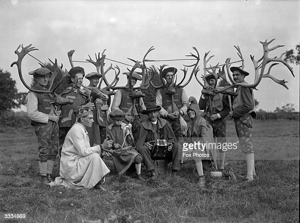 A group of Deer Men of Abbots Bromly Staffordshire with their antlers and kneelength breeches which are patterned with oak leaves With them are a...