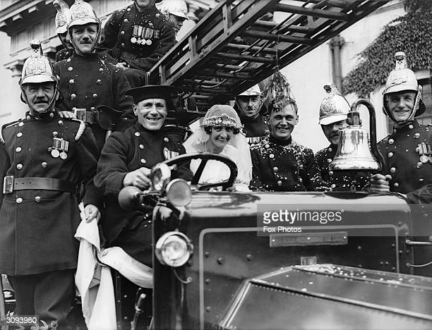 A fireman and his bride at Wanstead after their marriage