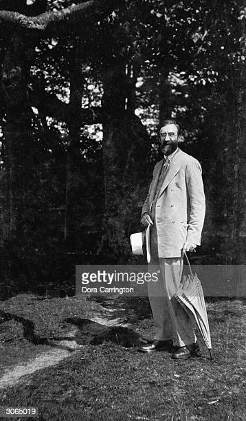 British biographer and literary critic Lytton Strachey at Ham Spray Wiltshire the home he shared with painter Dora Carrington andassociated with the...