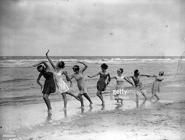 Morris dancers exercising on the sands at Saint-Idesbald.