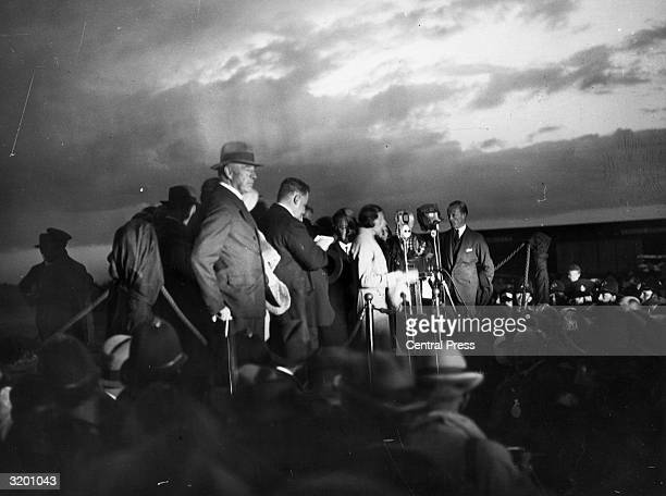 Aviatrix Amy Johnson arrives back at Croydon to an enthusiastic welcome after her historic solo flight from England to Australia