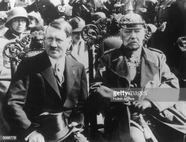 Chancellor of Germany Adolf Hitler with on right President of Germany Paul von Beneckendorff und von Hindenburg at Tannenburg Memorial Parade in East...