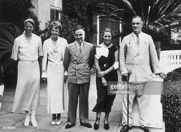 Left to right first Lady Eleanor Roosevelt aviator Amelia Earhart Jim and Amy Mollison and President Roosevelt in Hyde Park New York A week before...