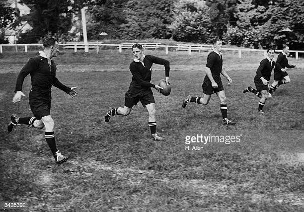 N Ball passing to a fellow All Black team member in a threequarter movement during a training session at Newton Abbott