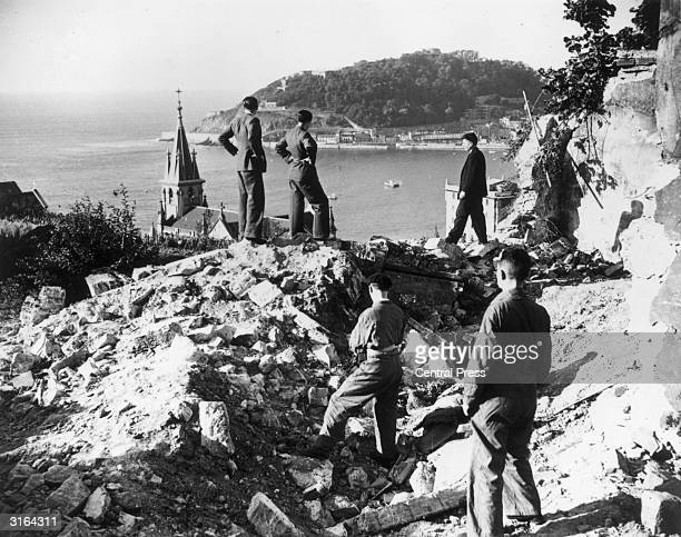 A wrecked house after the bombardment of San Sebastian by insurgent warships In the background can be seen Monte Urgell