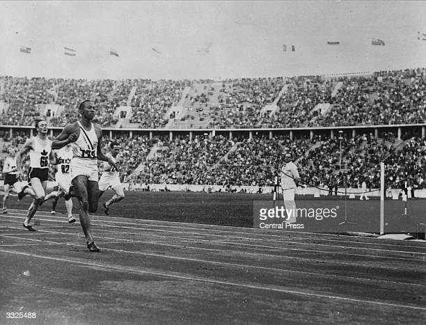 US athlete Jesse Owens competing in a race during the Olympic Games at Berlin He won four gold medals at the Berlin Olympics 100 metres 200 metres...