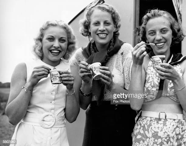 Three models eating Lyon's ice-cream cups at Bourne End in Buckinghamshire.