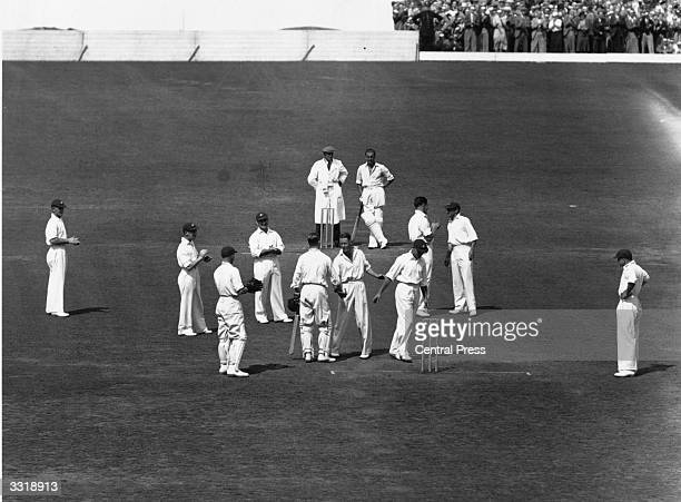 English cricketer Len Hutton who scored 364 is congratulated by Bill Brown on breaking Don Bradman's record during a test match between England and...