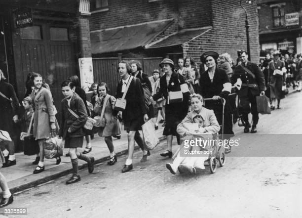 London school children including one with an injured foot heading for Black Horse Road School to join a party being evacuated from London