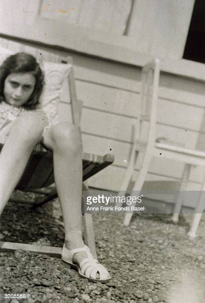 EXCLUSIVE Portrait of Anne Frank sunbathing on her family's roof taken from her photo album Merwedeplein Amsterdam Holland