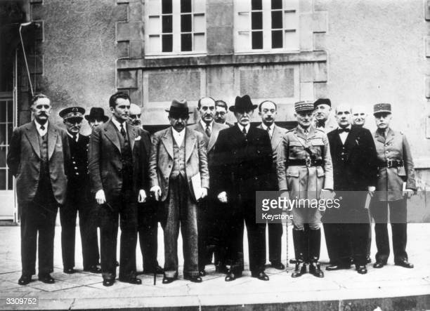 The Second French Vichy Government on the steps in the garden of the Pavillion de Sevigne at Vichy LR Front row Pierre Caziot Admiral JeanFrancois...