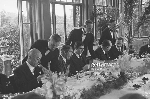 Guests at a lunch party at the Winter Garden of the Soviet Embassy in London given by Soviet Ambassador Ivan Maisky From left to right Belgian...