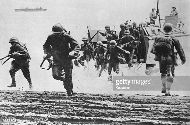American marines coming ashore from landing craft at Guadalcanal.