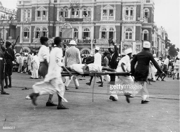 An injured man being taken away on a stretcher during the Bombay riots India Original Publication Picture Post 1057 India What Civil Disobedience...
