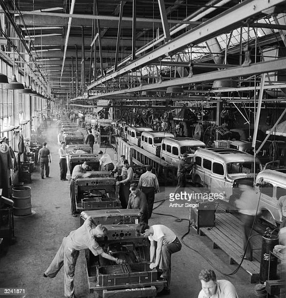 Interior view of a Chrysler corporation Dodge truck plant assembling trucks for the US army Detroit Michigan World War II