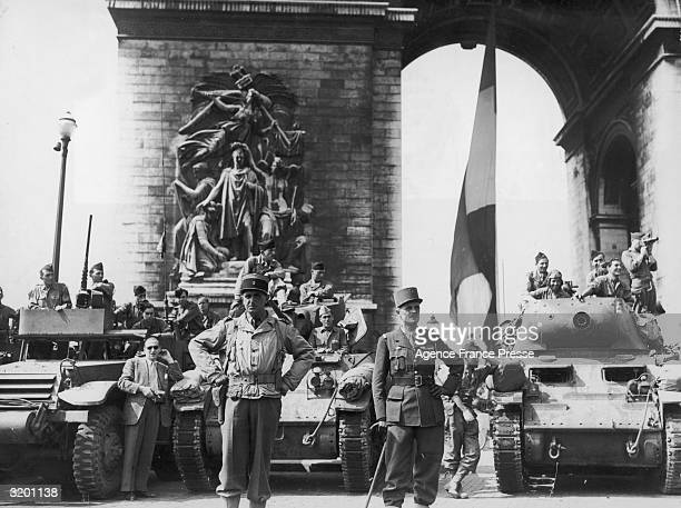 Fulllength image of General JacquesPhilippe Leclerc and 2nd Armored Division waiting in front of l'Arc de Triomphe during the liberation of Paris...
