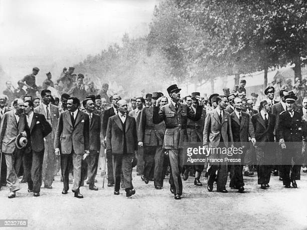 General Charles de Gaulle leads a crowd on the Champs Elysees after the liberation of Paris