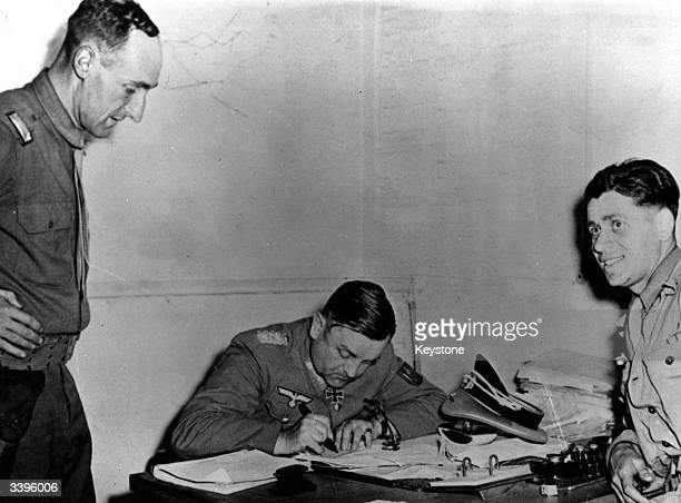 General Dietrich von Choltitz the Nazi commander of Paris signing the surrender of the Nazi troops after the French capital's liberation