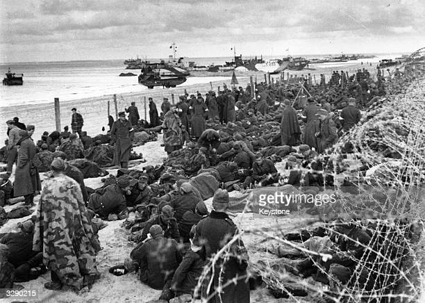 German prisoners on the beach in Normandy waiting to be deported to a prisoner of war camp