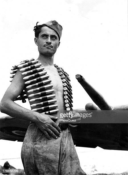 August 1944 - Yugoslav partisans train with the RAF in Italy - A typical Yugoslav partisan with a belt of 20mm cannon shells ready for leading into a...