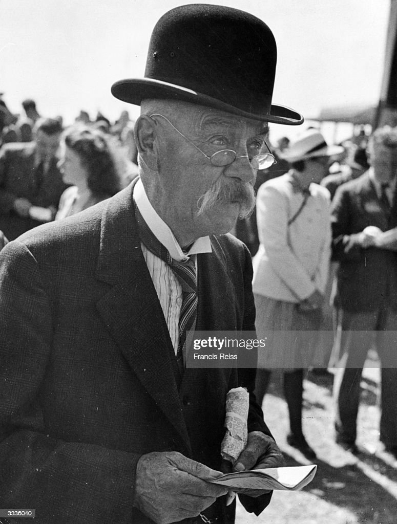 A spectator at the Galway Horse Races in Ireland. Original Publication: Picture Post - 2082 - Off To The Galway Races - pub. 1st September 1945