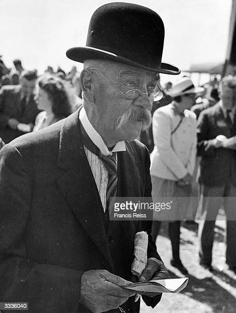 A spectator at the Galway Horse Races in Ireland Original Publication Picture Post 2082 Off To The Galway Races pub 1st September 1945