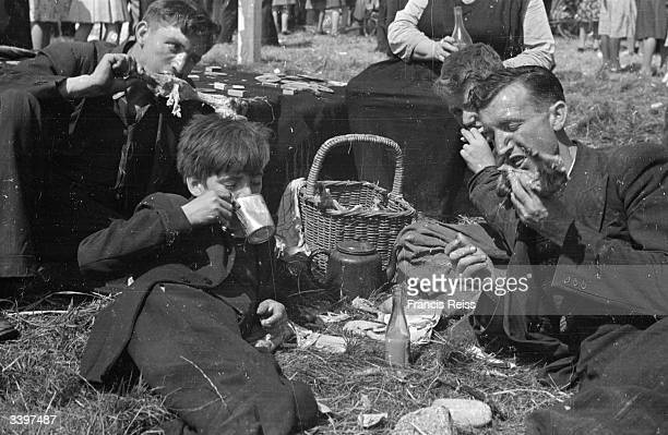 Racegoers having a lunchtime picnic at the Galway Races Ireland Original Publication Picture Post 2082 Off To The Galway Races pub 1st September 1945