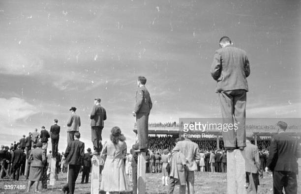 Racegoers standing on posts for a better view at the Galway Races Original Publication Picture Post 2082 Off To The Galway Races pub 1st September...