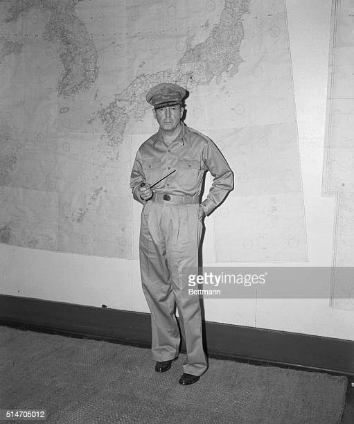 """August 1945-Manila, P.I.: NEARING THE END OF """"LONG, HARD ROAD"""". Gen. Of the Army Douglas MacArthur, holding his familiar pipe, plots the occupation..."""