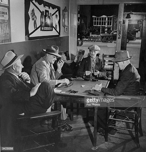 A group of men playing dominoes in Roy and Jim's Wichita Smoke House in Wichita Kansas