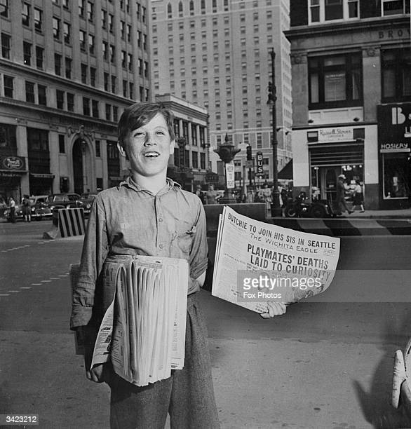 Dick Pearce selling newspapers on the corner of Douglas and Broadway in Wichita Kansas