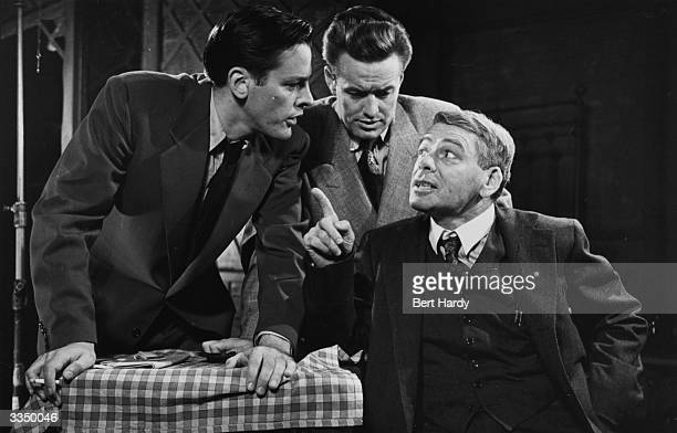 American actor Paul Muni right as Willy Loman and Kevin McCarthy as his son in a scene from Arthur Miller's play 'Death of a Salesman' at the Phoenix...
