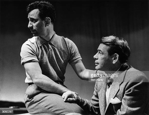 Paul Muni who plays the part of Willy Loman in Arthur Miller's 'Death of a Salesman' chats with producer Elia Kazan during a rehearsal at the Phoenix...