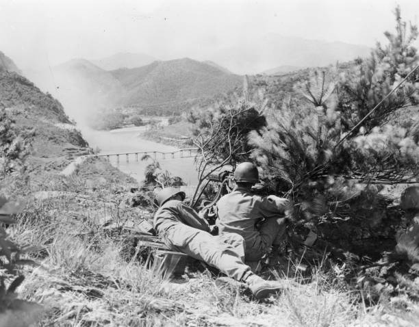 An American gun crew cover a bridge in the Korean War....
