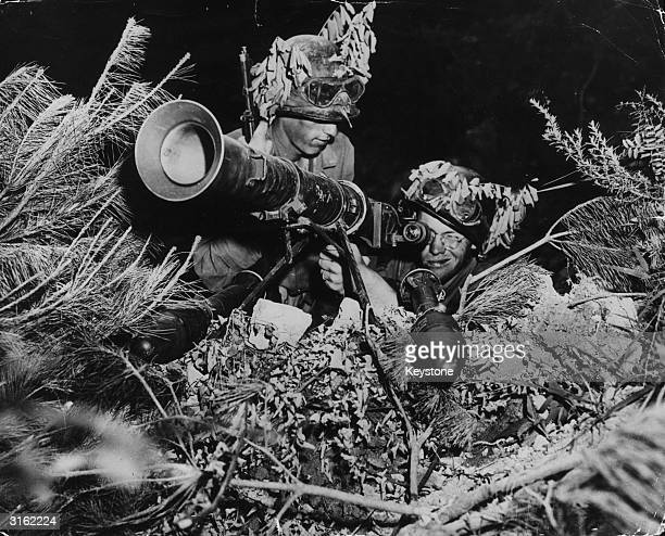 Two American soldiers operating a 3.5 inch rocket-launcher somewhere on the front line during the Korean War.