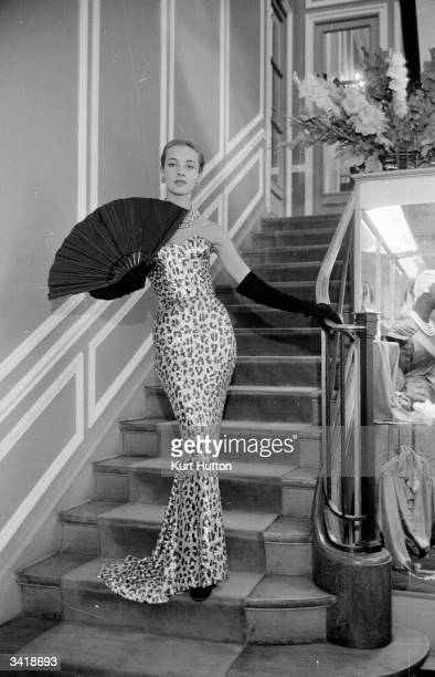 A model wearing one of Christian Dior's evening dresses from his Autumn / Winter collection in Paris Original Publication Picture Post 6685 Paris...
